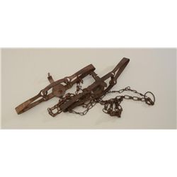 Pair of old Victor animal traps in uncleaned  condition.  Est.:  $75-$150.