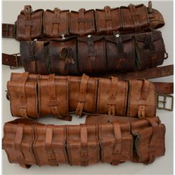 Lot of four leather and canvas European  military cartridge belts, each with five  attached cartridg