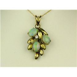 Stylish 14 karat yellow gold ladies leaf  design necklace set with three fine opals and  diamond wei