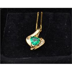 One heart shaped pendant set with a heart  shaped Chatham emerald and diamonds. Est.  $120-$240