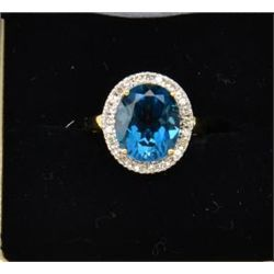 One ladies ring set with a London blue topaz  and diamonds in 10k yellow gold. Est.  $400-$500