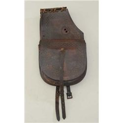 "Pair of tooled leather saddlebags marked  ""H.H.Heiser, Maker, Denver, Colo"" in overall  good conditi"