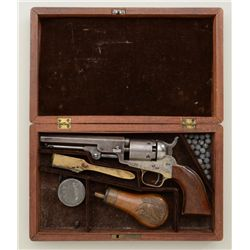 "Cased Colt Model 1849 pocket percussion  pistol, .31 cal., 5"" octagon barrel, blue and  case hardene"