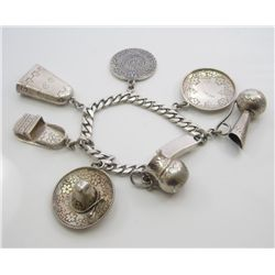 Splendid Sterling silver ladies multi charm  bracelet weighing over 64 grams. Estimate  $400-$600 Ni