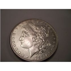 1899 MORGAN SILVER DOLLAR, AU-55