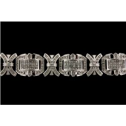BRACELET: 14KWG (stamped 14K) link bracelet set with 272 round and 256 princess cut diamonds
