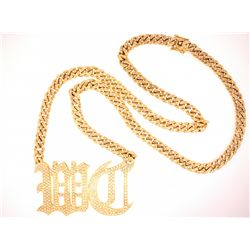 NECKLACE: 14KYG curb link chain with old English letters and set with 615 round diamonds
