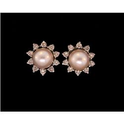 EARRINGS: 14KWG earrings set 20 rbc diamonds and 2 pearls
