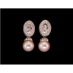 EARRINGS: 18KWG earrings set with 2 slight rose colored cultured pearls