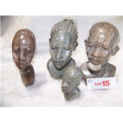 FOUR AFRICAN BUST STONE CARVINGS