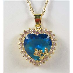 994 - GOLD PLATED BLUE SAPPHIRE & WHITE TOPAZ PENDANT W/ CHAIN