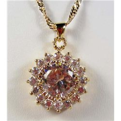 995 - GOLD PLATED PINK SAPPHIRE & WHITE TOPAZ PENDANT W/ CHAIN