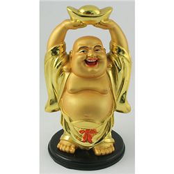 A Happy Buddha Holding Lucky Coin Bar for Wealthy Year