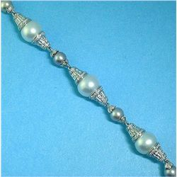 18K GOLD PEARL AND DIAMOND BRACELET