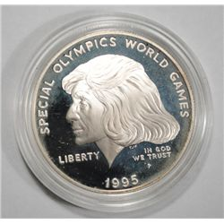 1995 Special Olympics silver $  in capsule no box  Est $40-$45