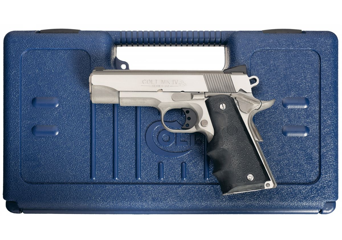 Stainless Colt MK IV Series 80 Combat Commander Model 1911 Semi-Automatic  Pistol with Case. Loading zoom