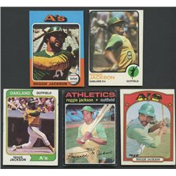 Lot of (4) Vintage Reggie Jackson Baseball Cards with 1971, 1972, 1973, 1974, 1975 Topps