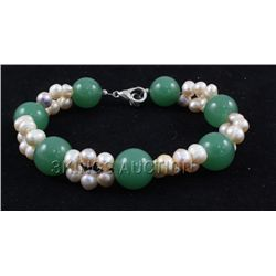 "140.81CTW 8"" GREEN FRESHWATER PEARL WITH CORAL BRACELET"