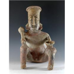 A Jalisco Seated Male Figure Holding a Club