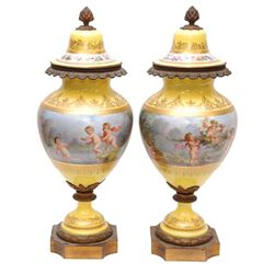 A PAIR OF 18th SEVRES PORCELAIN LIDDED URNS SIGNED