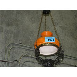 Cast metal with orange shade hanging lamp