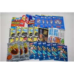 Lot of 26 unopened trading cards from NFL, NASCAR, NBA, and MLB; EST. $20-40