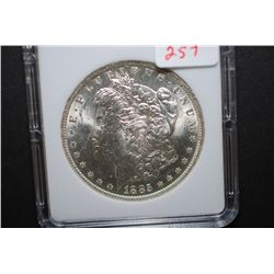 1885-O US Silver Morgan $1; MCPCG Graded MS63; EST. $50-75