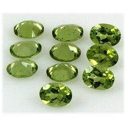 Peridot 12.74 ctw Loose Gemstone 6x8mm Oval Cut