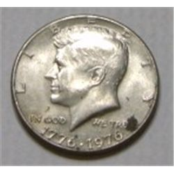 1976 KENNEDY HALF DOLLAR *PLEASE LOOK AT PICTURE TO DETERMINE GRADE*!!