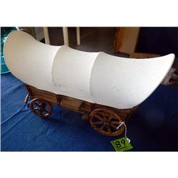 small wooden covered wagon