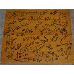 A piece of the original Williams Arena floor, autographed by many former Gopher Players and Coaches