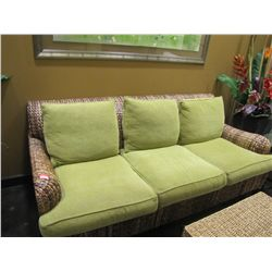 WICKER SOFA WITH GREEN PILLOWS