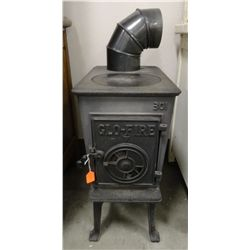 Glo-fire #301 cast iron heating stove 25''H x 12''W x 19'' D