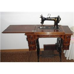 Singer treadle sewing machine with attachments and fancy cabinet