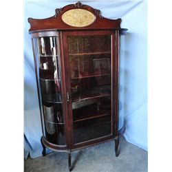 Mahogany curved glass china cabinet, beveled oval mirror
