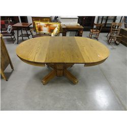 Round oak table 48'' wide, 2-12'' leaves