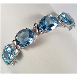 PLATINUM PLATE OVER STERLING SILVER BLUE TOPAZ BRACELET
