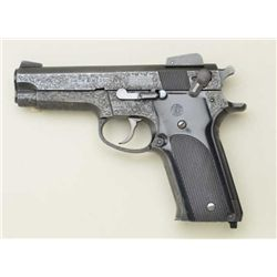 Smith & Wesson Model 559, 9mm semi-automatic  pistol with steel frame and factory A  engraved. Seria