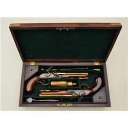 Pair of English Flintlock pistols in their  original case by Gill & Parker showing brass  barrels an