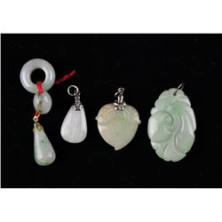 Four Finely Carved Chinese Jadeite Pendants