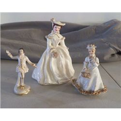 3- Porcelain  Figurines marked white & Gold 2- Lady's   1- man
