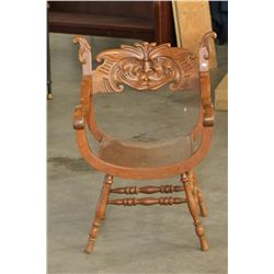 Antique Chair with Carved Face.