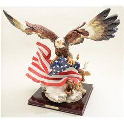 De Capoli Collection http://www.icollector.com/American-Eagle-cast-resin-and-painted-artwork-depicting-American-eagle-with-flag-De-Capoli-collec_i14986379