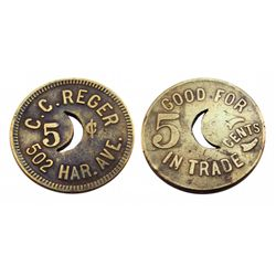 C.C. REGAR 5 cent token-502 HAR. AVE./GOOD FOR 5 CENTS IN TRADE/crecent moon pierced in middle of th