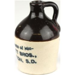 Miniature crock advertising jug marked