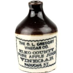 Antique miniature advertising jug front stamped