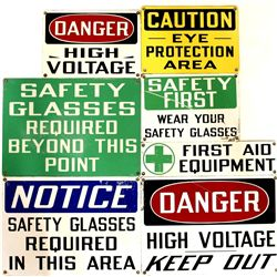 Collection of 7 contemporary metal safety signs.