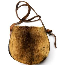 Antique leather shoulder bag with hair on
