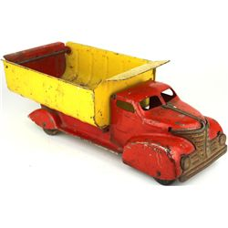 C. 1940's press tin toy dump truck