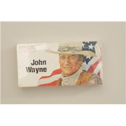 Box of John Wayne Commemorative Ammunition,  .32-40 caliber in fine condition.  Est.:   $75-$150.